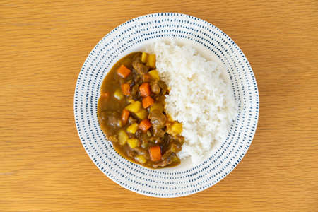 Home made Japanese beef curry served with Japanese rice in a plate close up. Japanese beef curry is one of the most favorite dish of Japan.