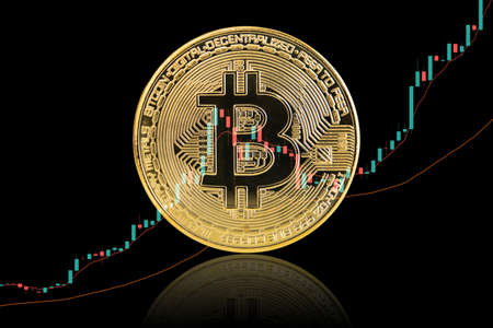 Mockup golden bitcoin close up on black background with clipping path. Bitcoin or BTC is the most popular cryptocurrency in the world powered by blockchain technology. Bitcoin, the digital currency. 免版税图像
