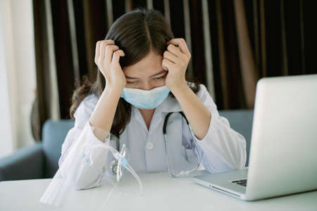 Hard working of Asian young female doctor in hospital, stressful - workaholic health care worker in hospital. Medication working tired from hard working.