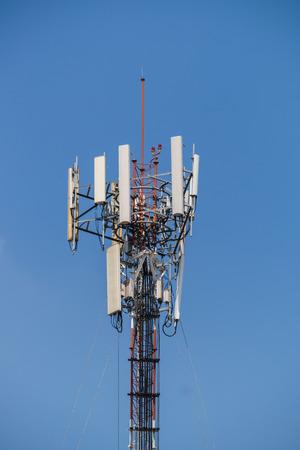 transmitter: High transmitter tower against blue sky