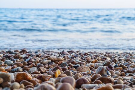 depth: Gravel Depth Of Field and blue sea background. Stock Photo