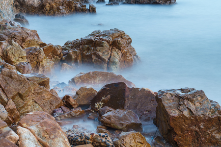 coastline: rocky coastline and long exposure Stockfoto