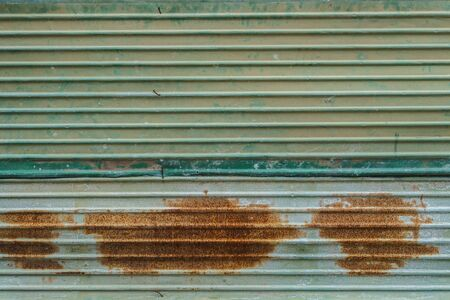 rusted background: Rusted corrugated zinc sheet wall background