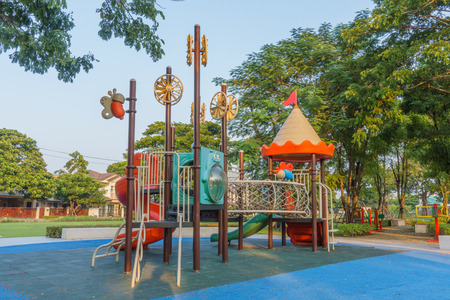 spirited: A colorful public playground in a garden Stock Photo