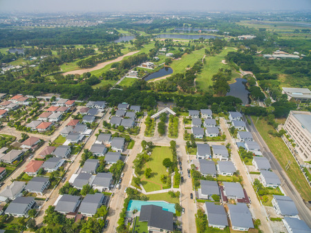 suburban neighborhood: aerial view of home village in bangkok thailand