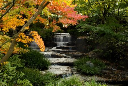 Artificial Waterfall in the garden Stock Photo