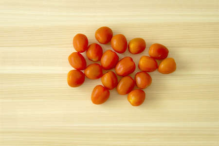 Cherry Tomato on wooden board