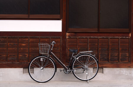 Bicycle with background of the Japanese old traditional house Stock Photo