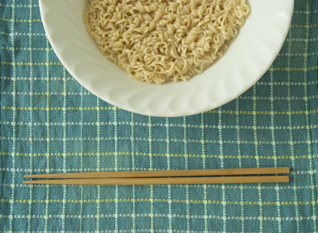 Boiled Instant Noodle in a bowl and Chopsticks