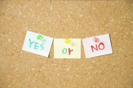 yes or no: Yes or No wording on sticky note put on Pin board