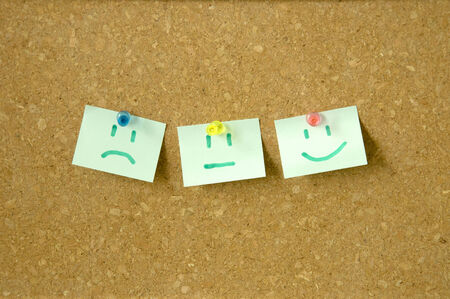 Emotion on sticky note pinned on pin board