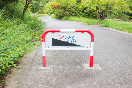 downhill: Caution downhill bike signs  slope. Stock Photo