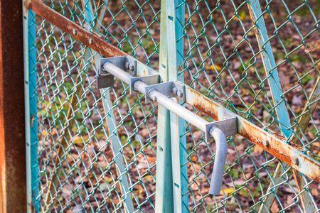 iron barred: Old fence locked metal door with rusty.