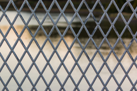 Metal grate pattern river background.