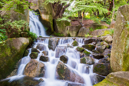 jumble: Beautiful Waterfalls over a jumble of moss-covered boulders in forest. Stock Photo