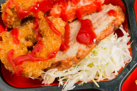 fritter: Japan Food of chicken fritter with Tomato Sauce  Japan food (Bento). Stock Photo