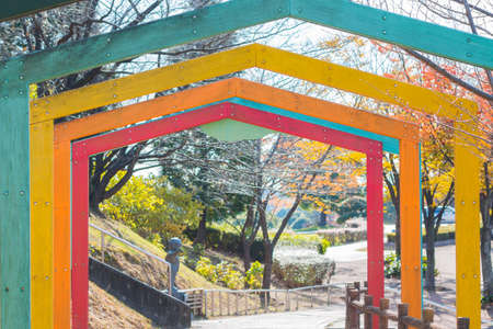sift: Colorful wooden tunnel in park.