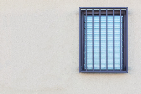 louvered: Empty wall texture with Glass louvered window. Stock Photo