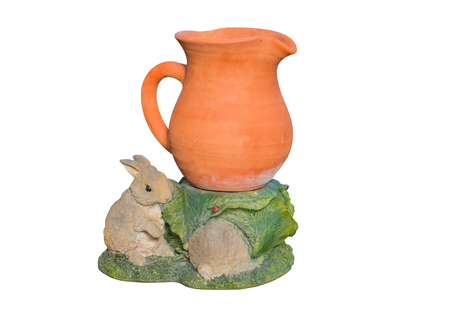 earthenware: Earthenware vase with rabbit plaster on white background. Stock Photo