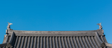 ancient japanese: Traditional roof of ancient japanese building with blue sky.