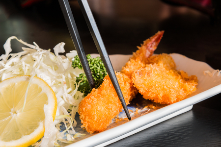 fritter: Fried prawn balls, shrimp fritter with lemon and cabbage slice.