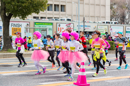 start to cross: NAGOYA, JAPAN - MARCH 13, 2016: Nagoya Womens Marathon 2016. Womens With more than 3,000 People running in the downtown. Course Start and finish at Nagoya Dome Distance 42.195km. Nagoya city Japan.