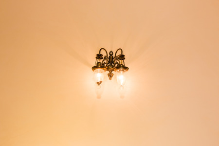 wall sconce: lamp light on the wall room. Stock Photo