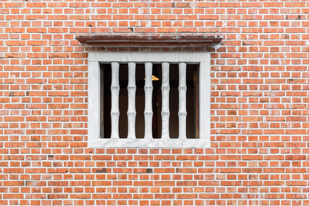 old window: Old red brick wall with White Window.