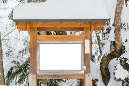 covered in snow: Wooden sign board, covered snow in winter concept.