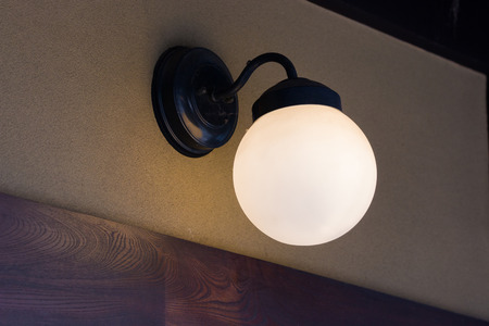 sconce: single lamp light on the wall room.