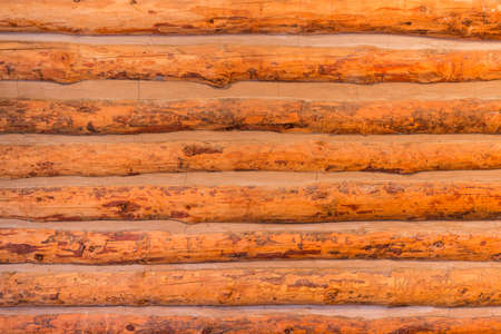 log wall: Wooden log wall texture background. Stock Photo