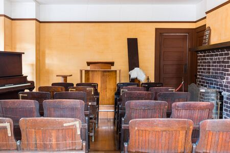 court proceedings: A empty witness chair inside a classic American courtroom.