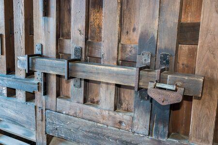 Old prison locked wooden key, wooden gate lock