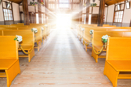 church interior: church interior with empty a row of wooden pews.
