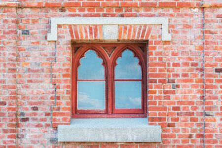 red brick: Old red brick wall with traditional Window.