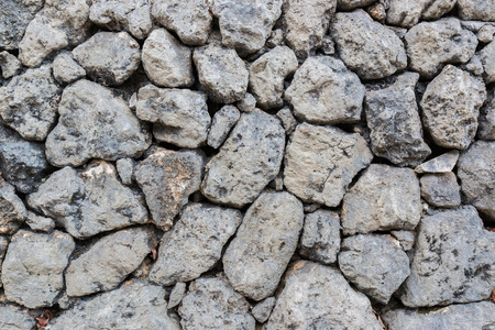 rock stone: the Rock wall texture background. Stock Photo