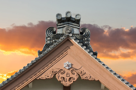 ancient japanese: Traditional roof of ancient japanese building with sunset sky.