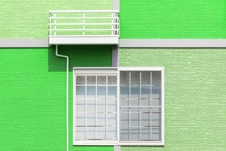 decorative balconies: Exterior home design by colorful wall and window