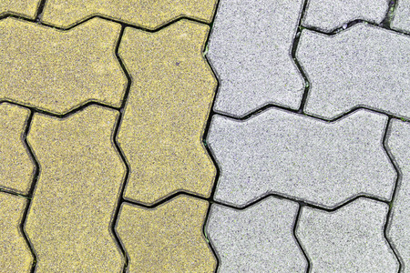 serrated: concrete floor serrated brick pattern texture for background. yellow and gray