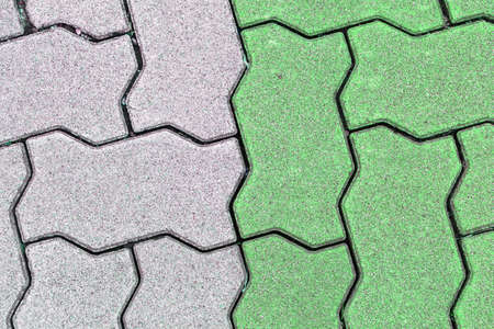 serrated: concrete floor serrated brick pattern texture for background. green and gray
