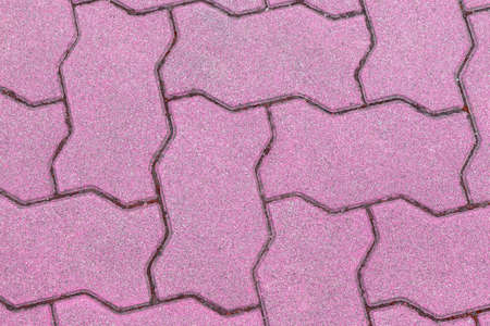 serrated: concrete floor serrated brick pattern texture for background. pink
