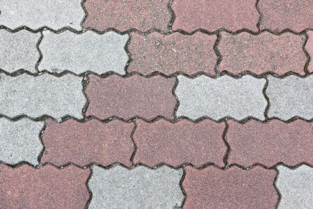 serrated: concrete floor serrated brick pattern texture for background. Red and gray