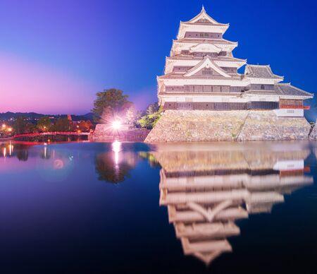 matsumoto: Matsumoto castle (Matsumoto-jo) historic landmark at night with beautiful reflection in water in matsumoto city nagano Japan. Editorial