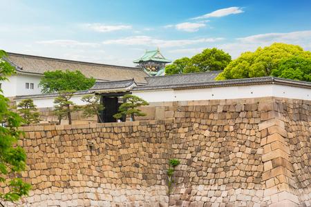 Wall outside of Osaka castle is historic landmark in osaka city japan in summer.