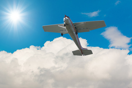 private plane: Private plane fixed wing single engine aircraft flying in the sky. Stock Photo
