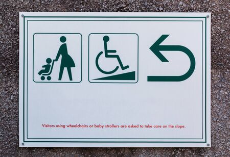handicap sign: Baby stroller sign and Handicap cripple sign with arrow for directions. Stock Photo