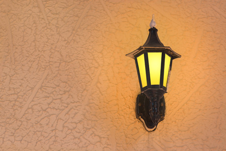 wall sconce: Retro lantern bright on the wall with copy space.