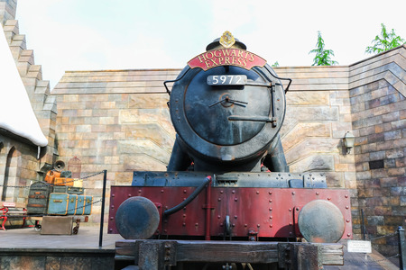 OSAKA, JAPAN - May 5, 2016: Universal Studios Japan (USJ). located in Osaka. Kings Cross Station. Students of Hogwarts School of Witchcraft and Wizardry take the scarlet steam engine named the Hogwarts Express