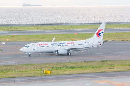 headquartered: AICHI, JAPAN - JUNE 26, 2016: China Eastern Airlines in Chubu Centrair International Airport Japan, China Eastern Airlines is an airline headquartered in Changning District, Shanghai, China.