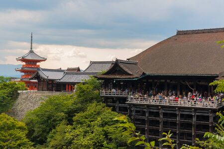 dera: KYOTO, JAPAN - July 31, 2016: Tourist at Kiyomizu-dera Temple in Kyoto Japan. Kiyomizu-dera is an independent Buddhist temple in eastern Kyoto. The temple is part of the Historic Monuments of Ancient Kyoto.